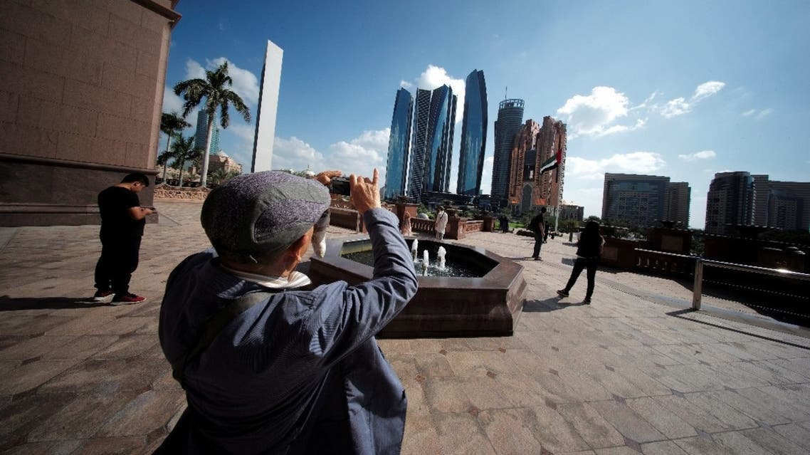 A tourist takes photos of Emirates Towers from the Emirates Palace Hotel in Abu Dhabi, United Arab Emirates, December 23, 2018. (Reuters)