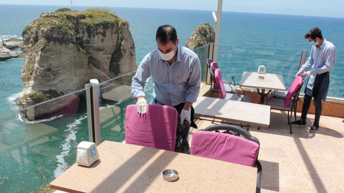 Waiters fix chairs at a restaurant overlooking the Pigeons Rock, in Beirut, Lebanon May 4, 2020. (File Photo: Reuters)