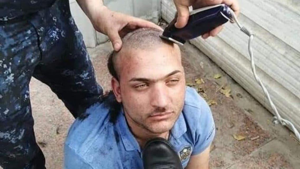 عراقي انتقد الشرطة الاتحادية فحلقوا رأسه