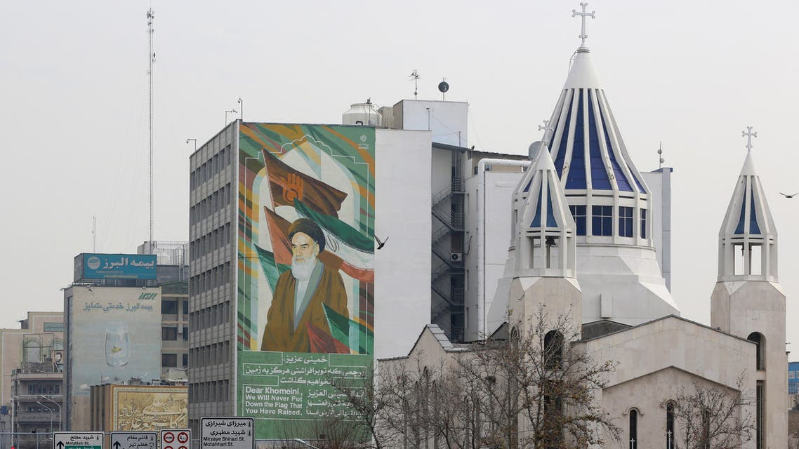 A view of the Saint Sarkis Armenian Cathedral, next to a building bearing a drawing of the late founder of the Islamic republic Ayatollah Ruhollah Khomeini, in Tehran on January 1, 2020. (AFP)