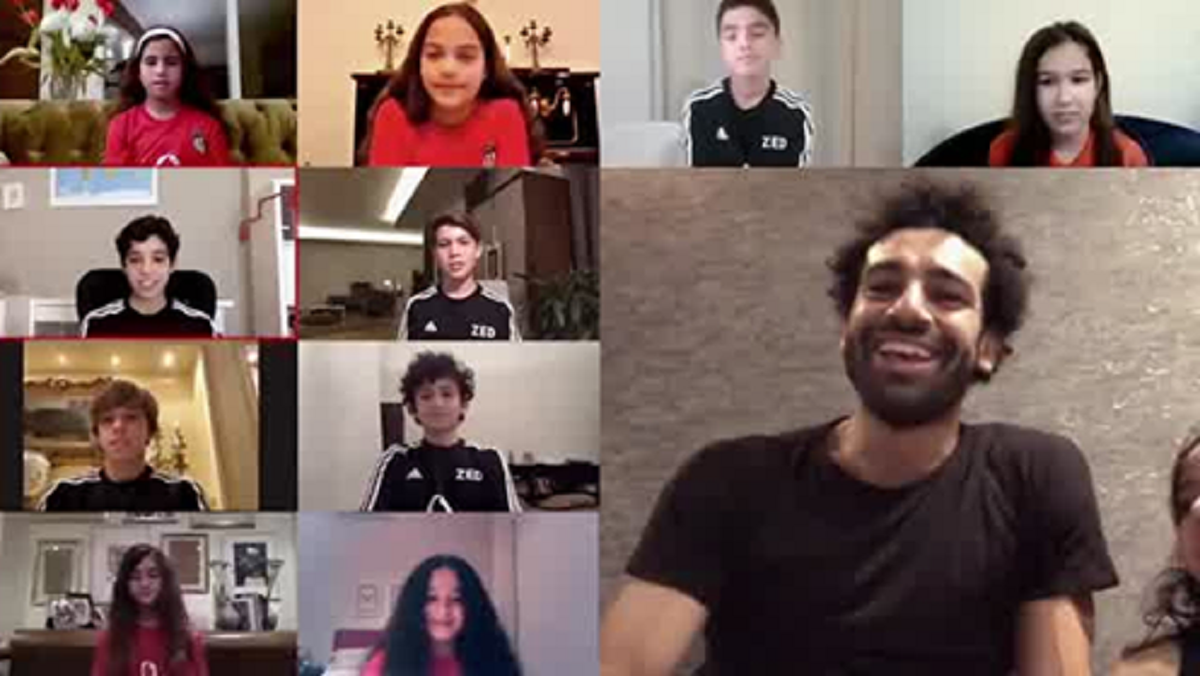 Football star Mohamed Salah appears in a video call with young fans. (Twitter)