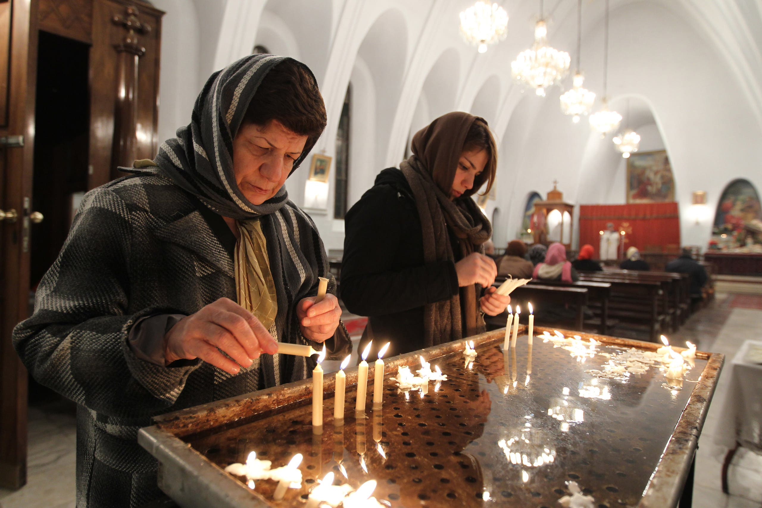 Iranian Christian women light candles at the St. Gregor Armenian Catholic church in Tehran on December 24, 2011. (File photo: AP)
