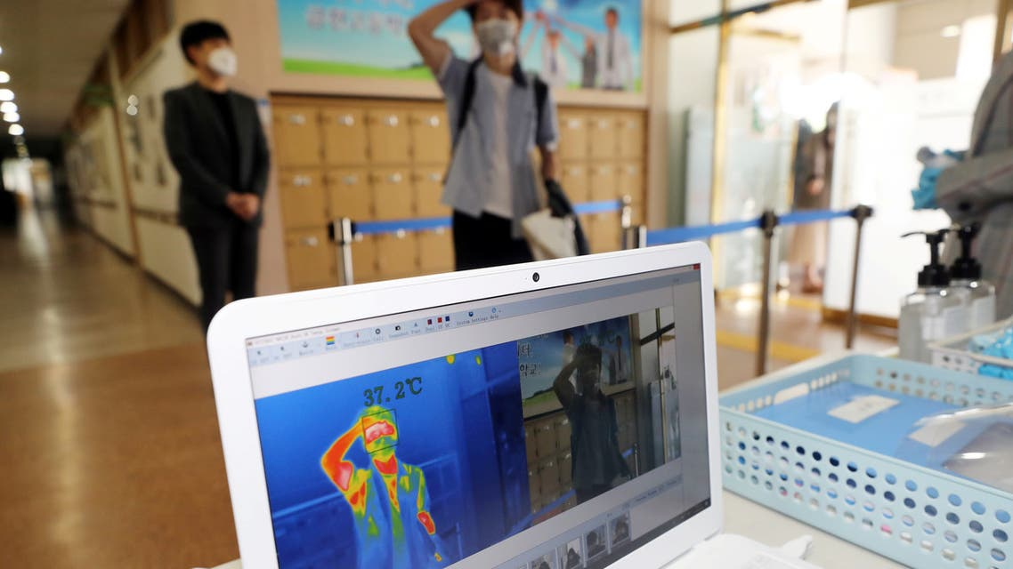A students gets his temperature checked with a thermal imaging camera as a high school reopens, following the global outbreak of coronavirus disease (COVID-19), in Chungju, South Korea. (Reuters)