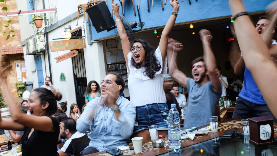 Cafe Em Nazih, a popular restaurant in Beirut, Lebanon, is shown full of patrons during a 2018 World Cup game. Now, compounding economic and coronavirus crises leave the restaurant facing an uncertain future. (Finbar Anderson)