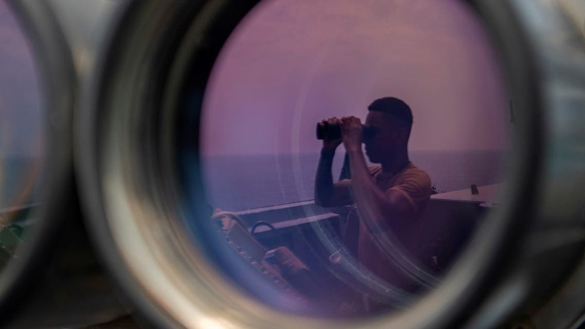 A US sailor uses binoculars to scan the ocean during a bridge watch aboard the guided-missile destroyer USS Bainbridge (DDG 96) in the Gulf, in this undated handout picture released by US Navy on August 3, 2019. (Reuters)