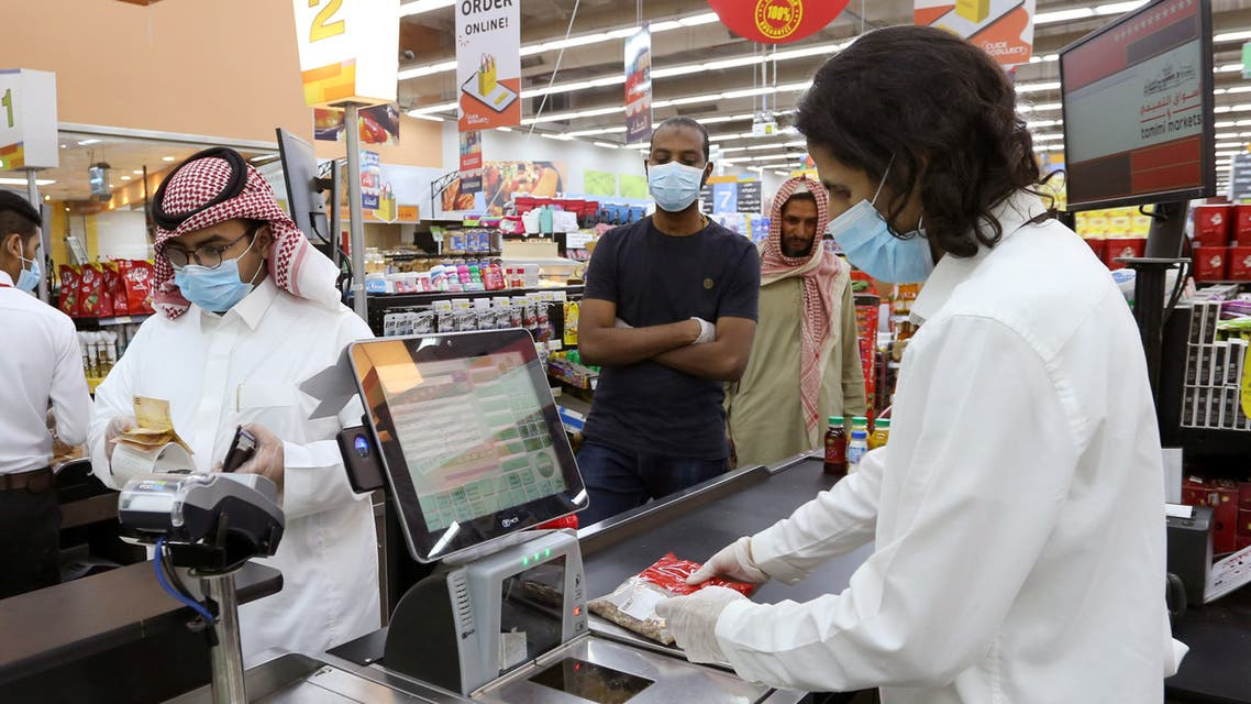 People wearing protective face masks and gloves shop at a supermarket, following the outbreak of the coronavirus, in Riyadh, Saudi Arabia, May 11, 2020. (Reuters)