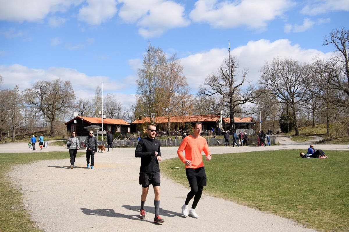 People walk and relax at the recreational area Hellasgarden, amid the outbreak of the coronavirus disease (COVID-19), in the outskirts of Stockholm, Sweden. (Reuters)