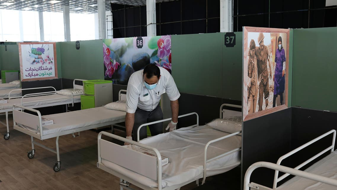 A medical aid worker sets up and installs a bed at a shopping mall, one of Iran's largest, which has been turned into a centre to receive patients suffering from the coronavirus disease (COVID-19), in Tehran. (Reuters)
