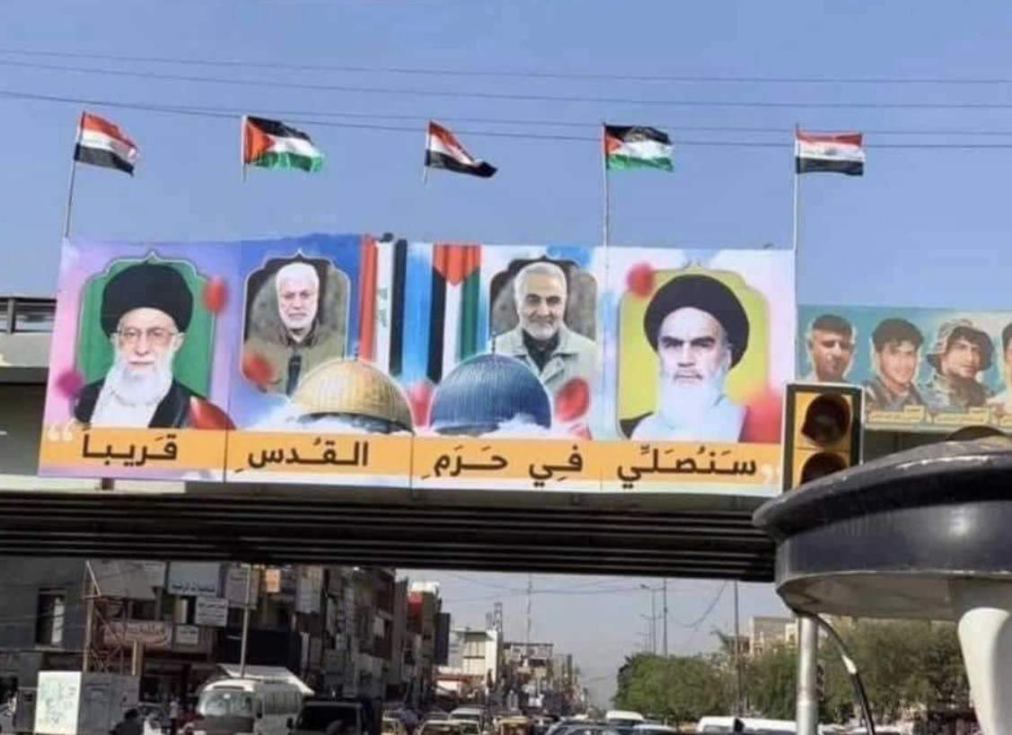 A poster in Baghdad which shows the faces of Khamenei, slain military commander Qassem Soleimani, former supreme leader Ayatollah Ruhollah Khomeini and slain Iraqi militia leader Abu Mahdi al-Mohandes. (Twitter)