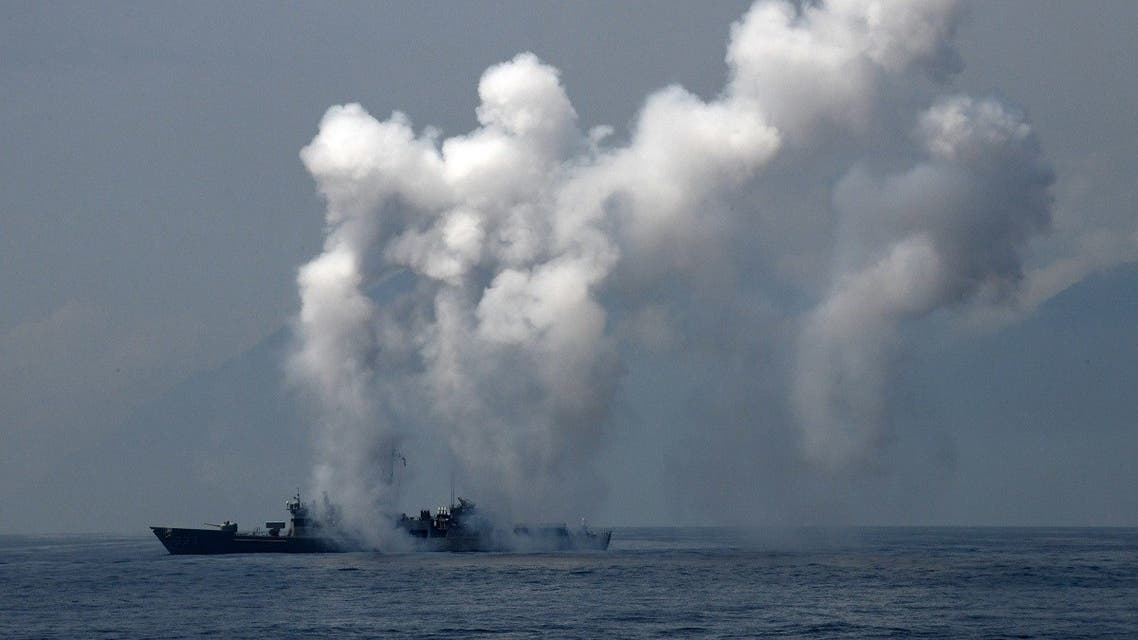 A frigate launches chaff and flare during a drill at the sea near the Suao navy harbour in Yilan, eastern Taiwan. (File photo:AFP)