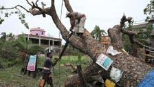 Indian PM visits cyclone-hit Kolkata promising help, Bangladesh estimates damage