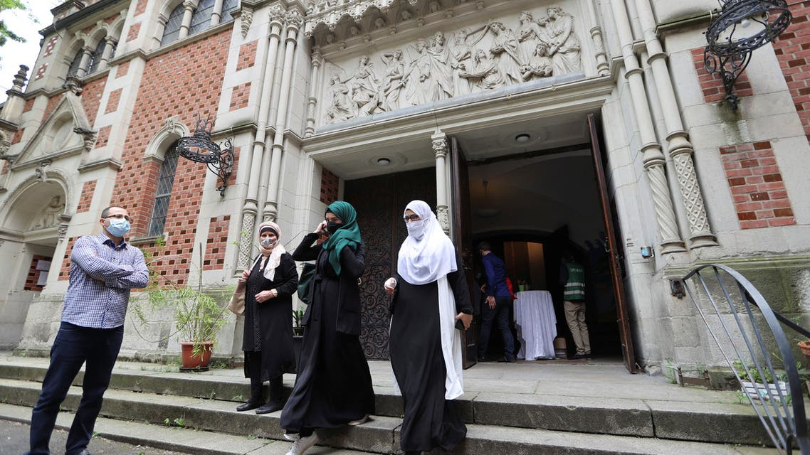 Muslims leave the evangelical church of St. Martha's parish, after their Friday prayers, in Berlin, Germany, on May 22, 2020.  (Reuters)