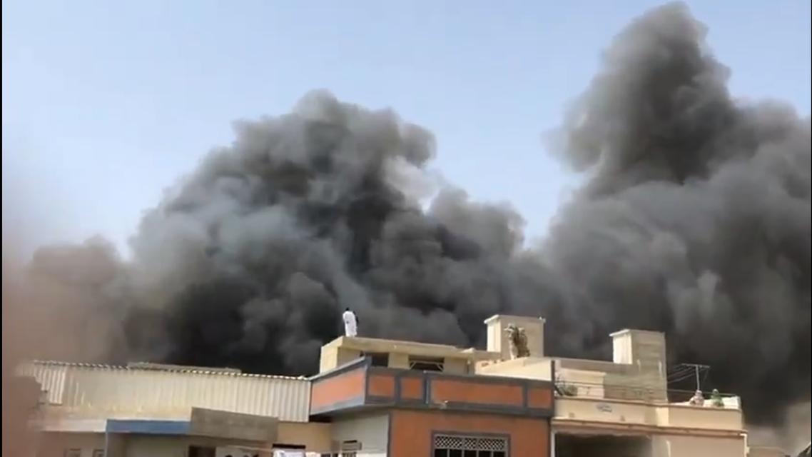 Unverified image reportedly showing the smoke billowing from the Pakistan International Airlines crash in Karachi. (Twitter, @YusraSAskari)