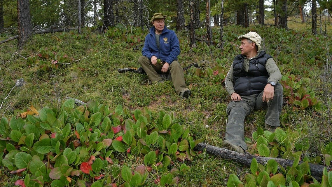 In this file photo taken on October 06, 2019 President Putin (L) and Defense Minister Shoigu speak during Putin's leisure time in the Siberian Taiga area. (AFP)