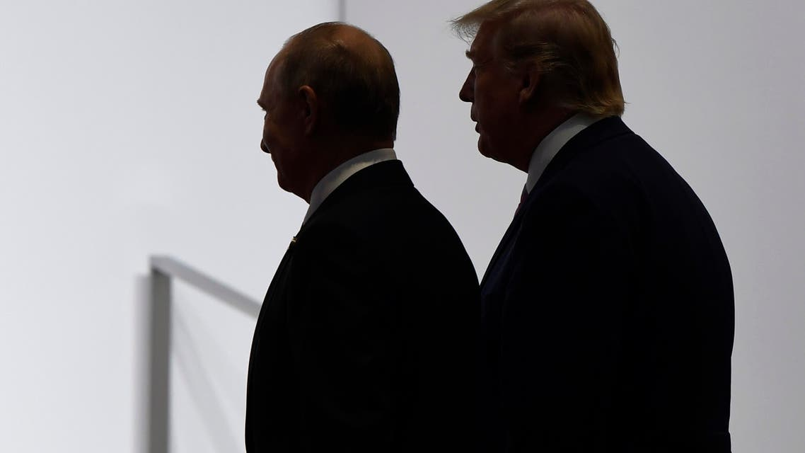 In this June 28, 2019, file photo, President Donald Trump and Russian President Vladimir Putin walk to participate in a group photo at the G20 summit in Osaka, Japan. (AP)