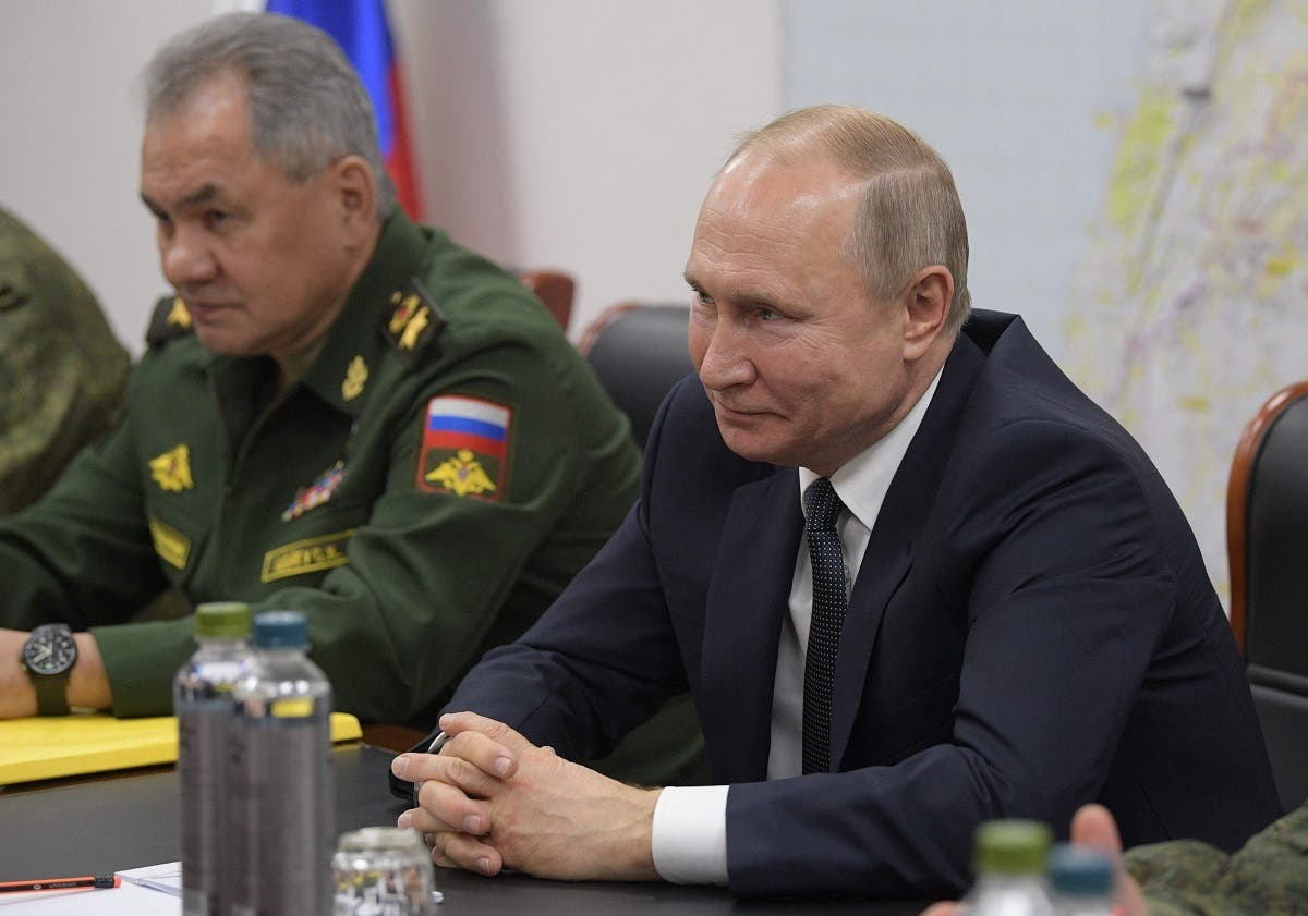 President Putin, accompanied by Defense Minister Shoigu, meets with Syrian President (unseen) at the headquarters of the Russian forces in the Syrian capital Damascus on January 7, 2020. (AFP)