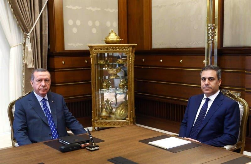 الرئيس التركي رجب طيب أردوغان ورئيس الاستخبارات التركية هاكان فيدان