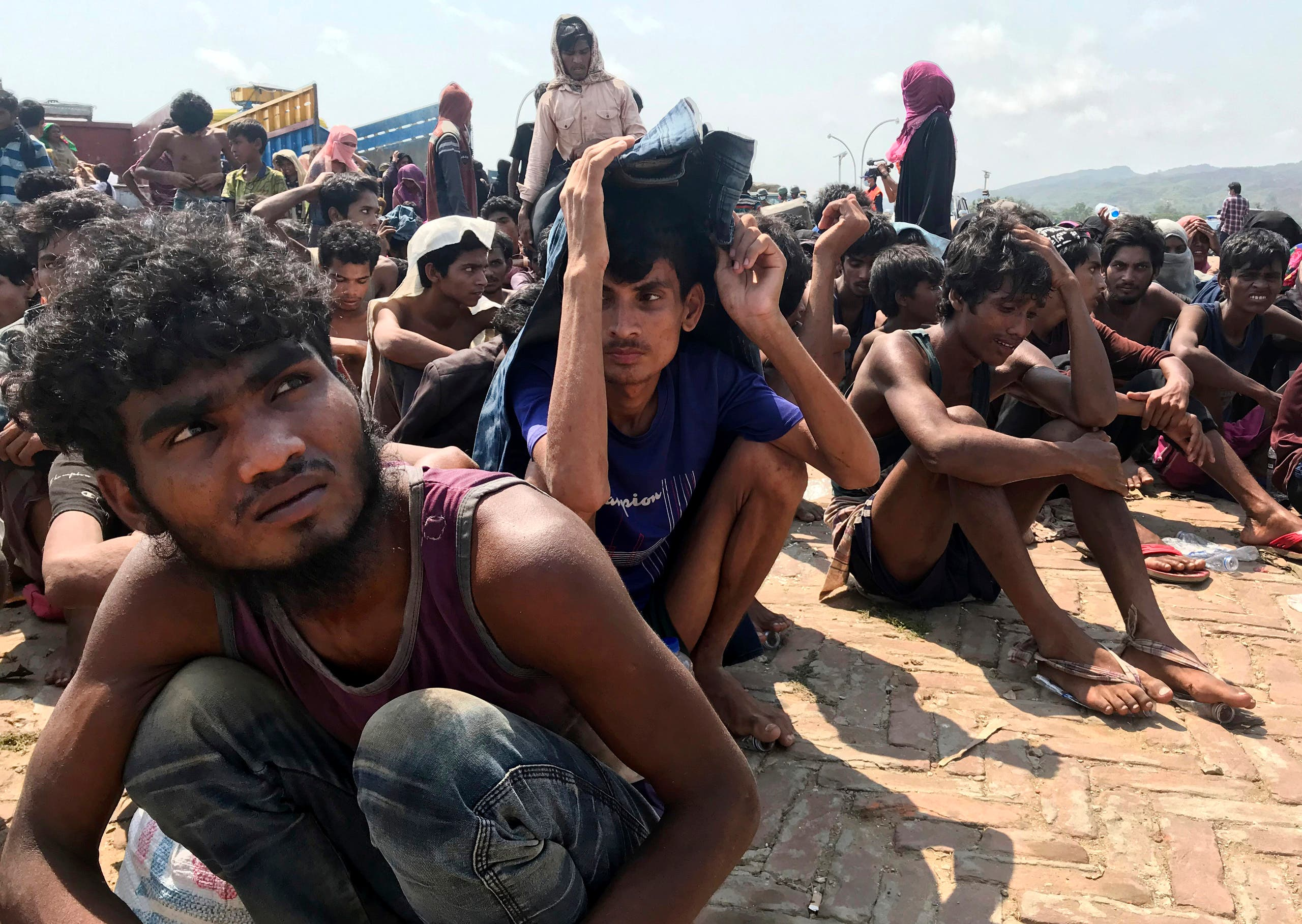 Rohingya refugees gather after being rescued in Teknaf near Cox's Bazar, Bangladesh, on Thursday, April 16, 2020. (AP)