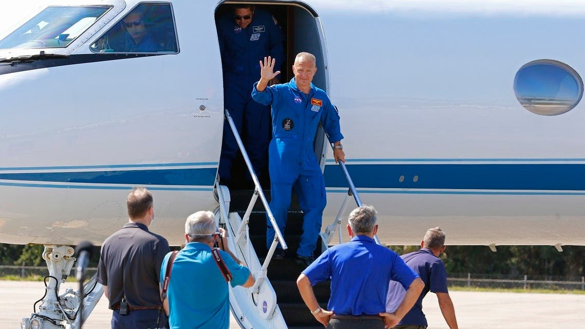 NASA astronauts Bob Behnken and Doug Hurley arrive at the Kennedy Space Center to prepare for the launch of SpaceX's Crew Dragon capsule, at Cape Canaveral, Florida. (Reuters)