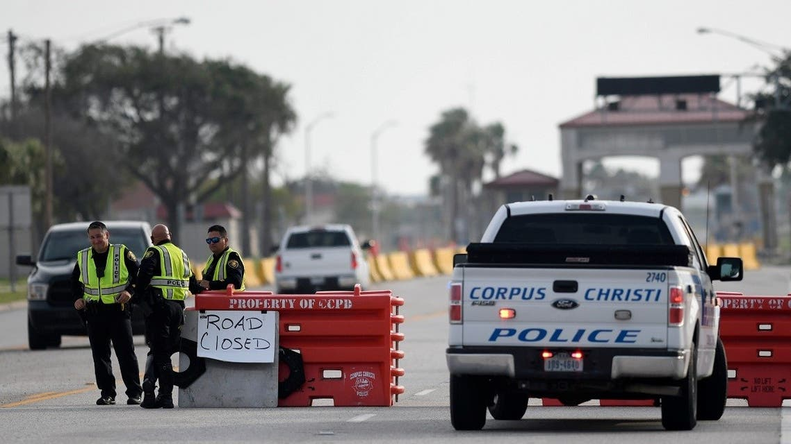 Police officers stand at a checkpoint after a shooting incident at Naval Air Station Corpus Christi. (Reuters)