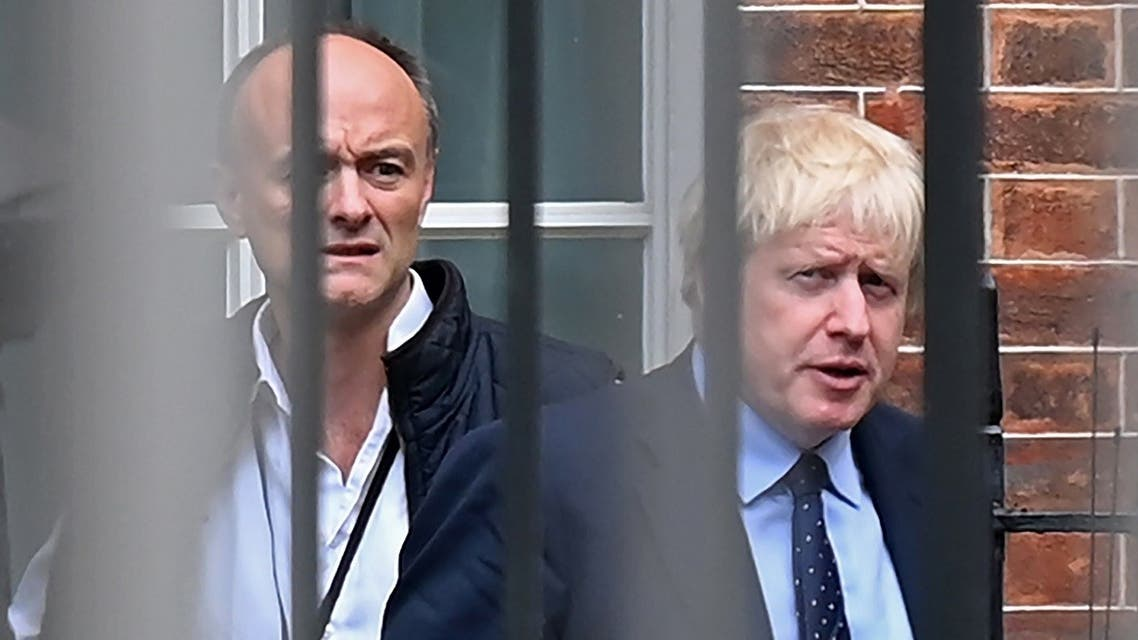 In this file photo taken on September 03, 2019 Britain's Prime Minister Boris Johnson (R) and his special advisor Dominic Cummings leave from the rear of Downing Street in central London. (AFP)