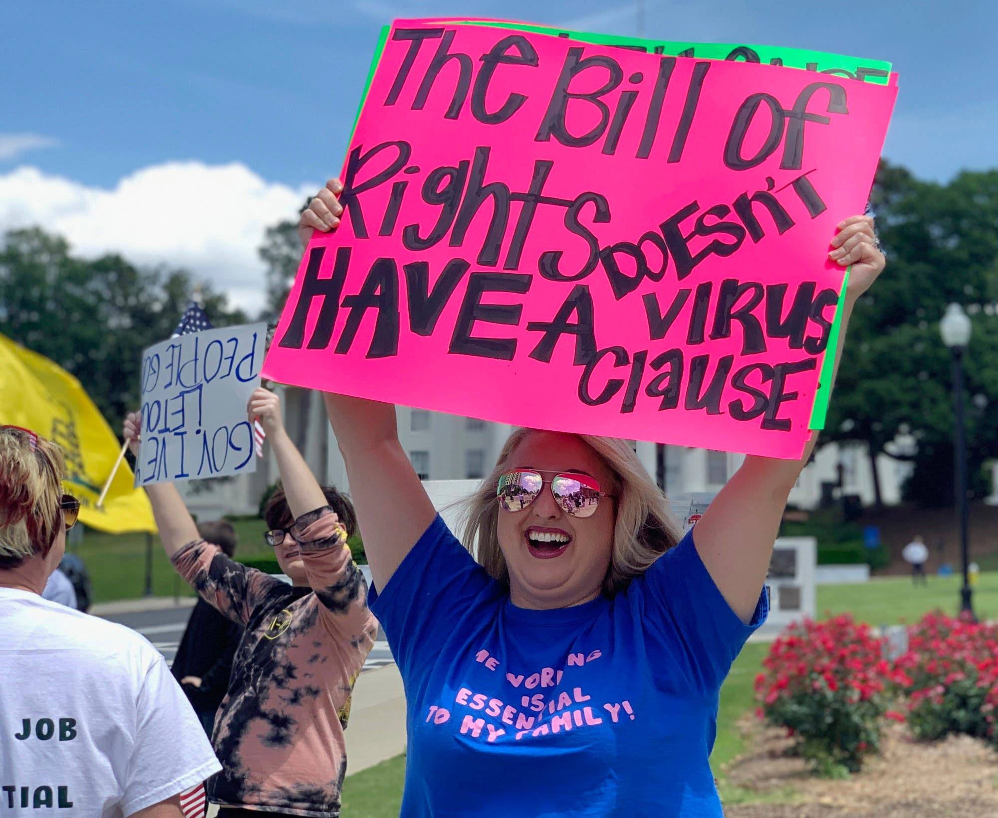 Kimmy Tillery, a hair-dresser from Tuscaloosa, Alabama holds a sign during a protest to reopen Alabama's economy outside the Capitol in Montgomery, on Tuesday, April 21, 2020. (AP)