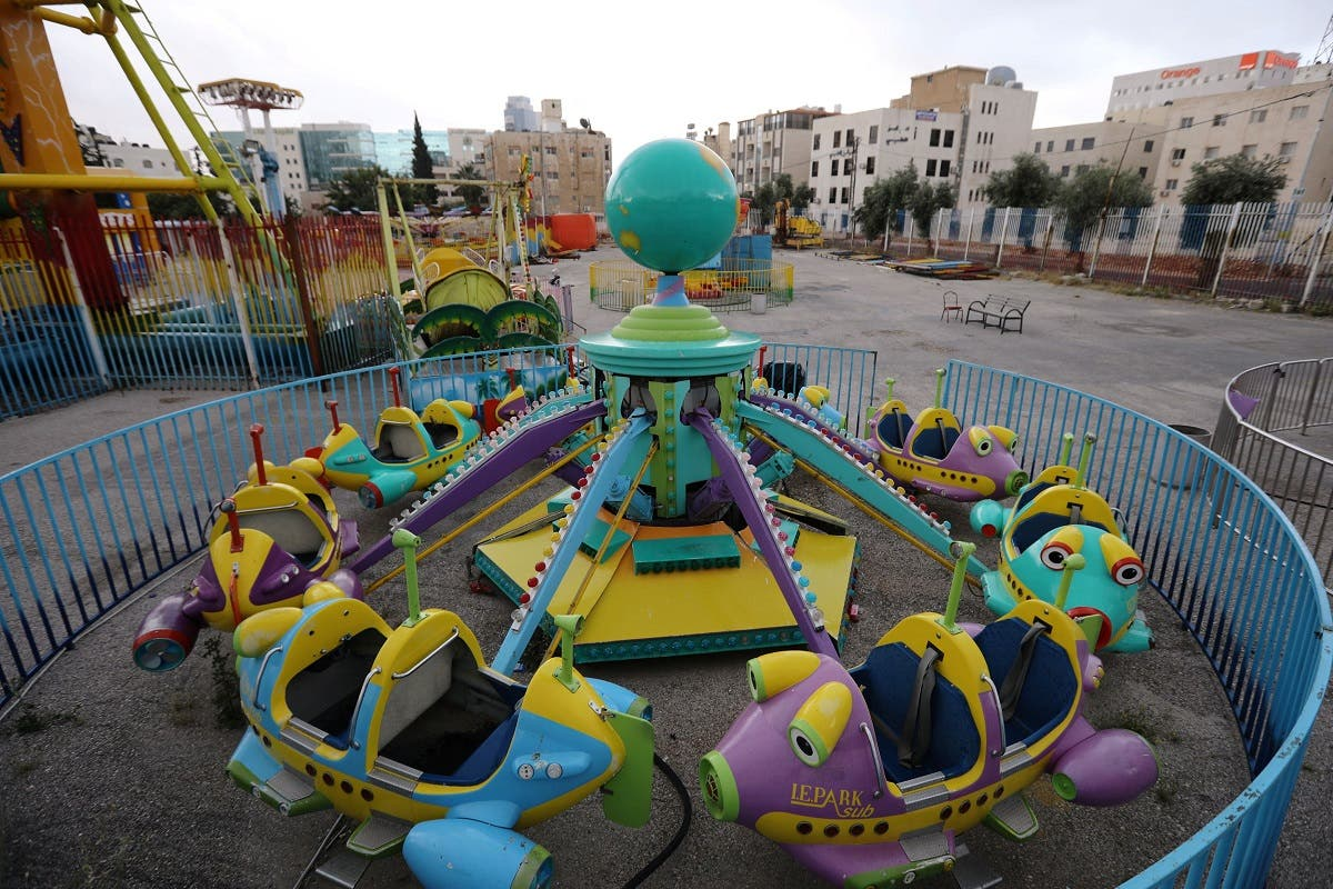 An amusement park is seen empty during the first day of Eid al-Fitr after the government imposed a full lockdown amid the spread of the coronavirus disease (COVID-19), in Amman, Jordan May 24, 2020. (Reuters)