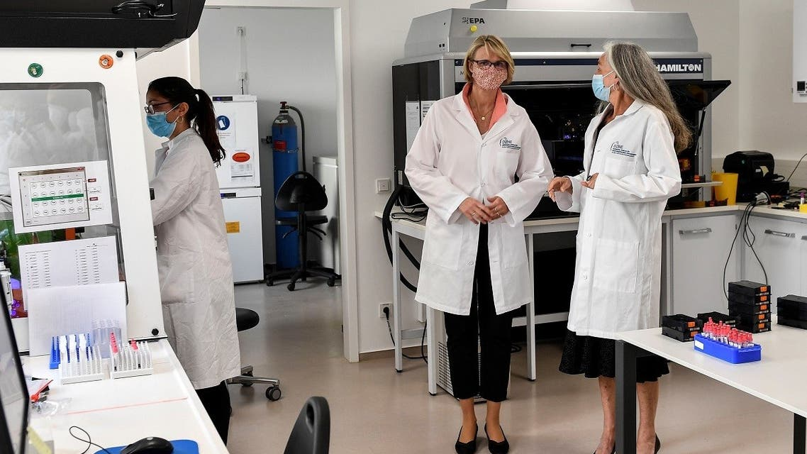 German Minister of Education and Research Anja Karliczek, center, talks with doctor Monique Breteler, during a visit at the German Center for Neurodegenerative Diseases (DZNE) in Bonn, Germany May 18, 2020. (Reuters)