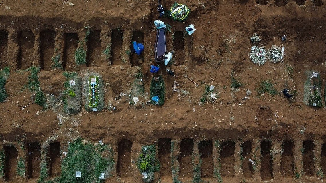 Aerial picture showing gravediggers burying an alleged COVID-19 victim at the Vila Formosa Cemetery, in the outskirts of Sao Paulo, Brazil on May 22, 2020. (AFP)