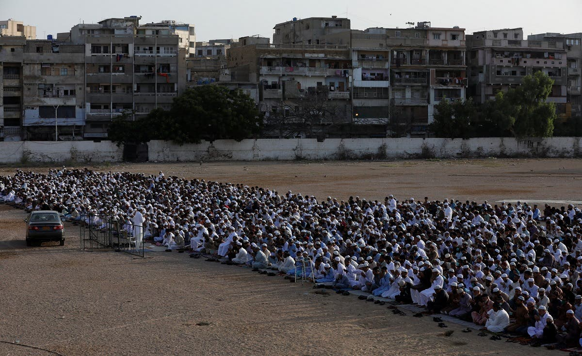 Pakistani Muslims celebrate Eid al-Fitr prayers to mark the end of the holy fasting month of Ramadan, amid the coronavirus disease (COVID-19) outbreak in Karachi, Pakistan May 24, 2020. (Reuters)