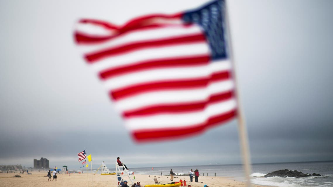 People enjoy the day at Long Branch beach after New Jersey beaches were opened ahead of the Memorial Day weekend in Long Branch, New Jersey. (AP)