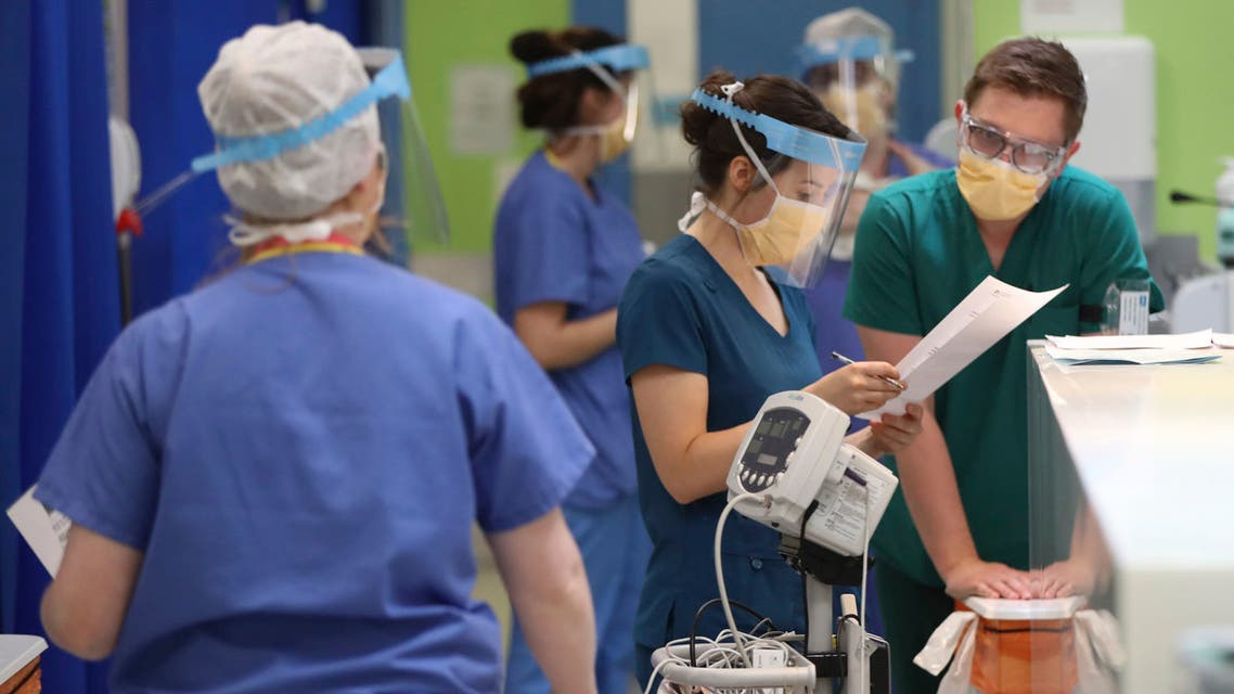Medical staff wearing face masks and shields to protect against coronaviurs, work in the respiratory emergency department at Craigavon Area Hospital in Co Armagh, Northern Ireland on May 4, 2020. (AP)
