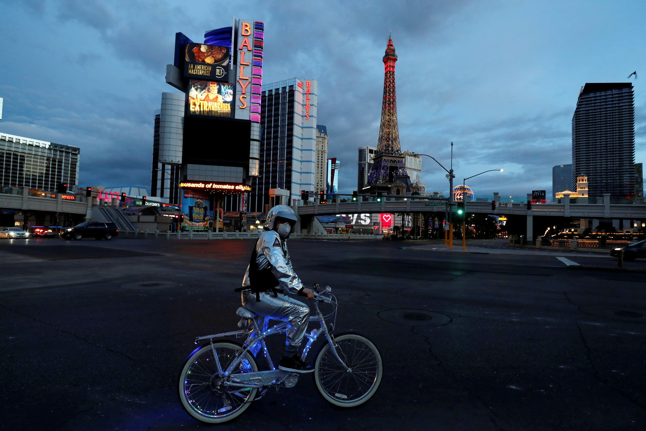 A man stands on his bicycle on the Las Vegas strip as the spread of COVID-19 continues, in Las Vegas, Nevada on April 10, 2020. (Reuters)