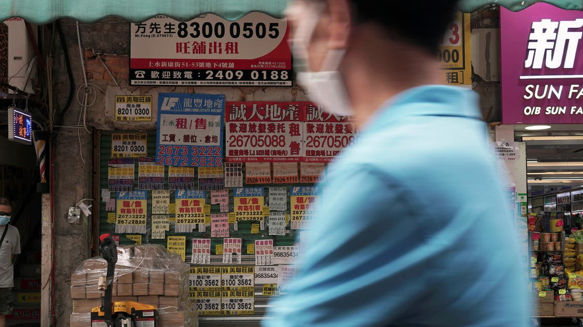 A man wearing a face mask walks past a shuttered shop space covered in rental advertisements, after the border between Shenzhen and Hong Kong was shut due to the coronavirus disease (COVID-19) outbreak, in Hong Kong's northern town of Sheung Shui, China May 18, 2020. (Reuters)