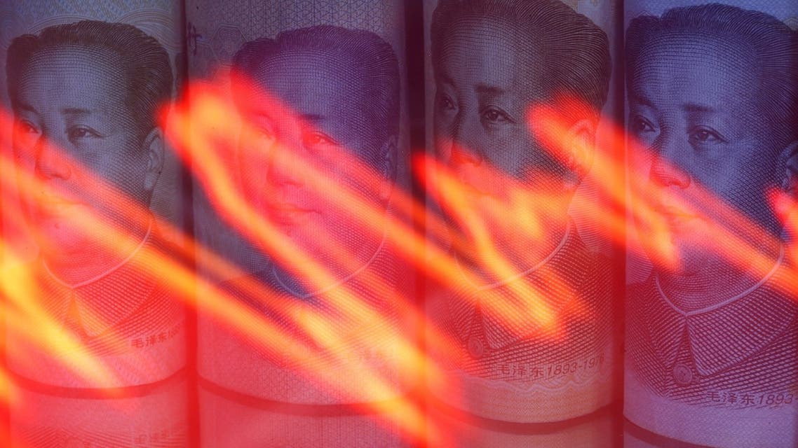 Chinese Yuan banknotes are seen behind illuminated stock graph in this illustration taken February 10, 2020. (Reuters)