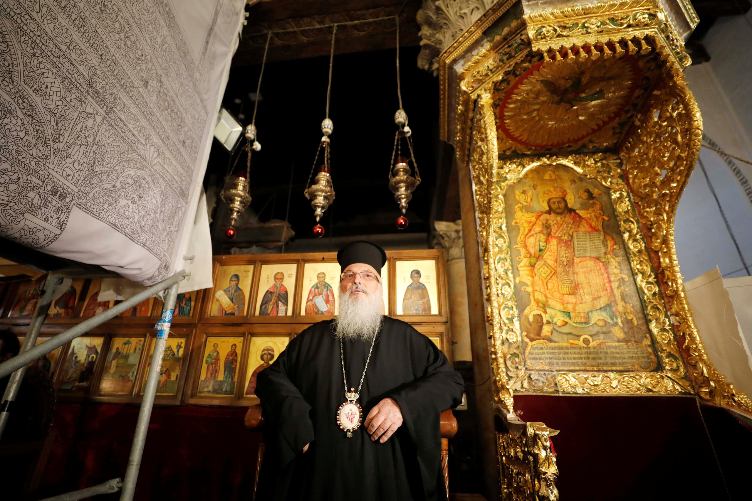 The head of the Greek Orthodox Church in Bethlehem, bishop Theophylactos, reopens the Church of the Nativity as Palestinians ease restrictions of the coronavirus disease (COVID-19), in Bethlehem in the Israeli-occupied West Bank May 26, 2020. (Reuters)
