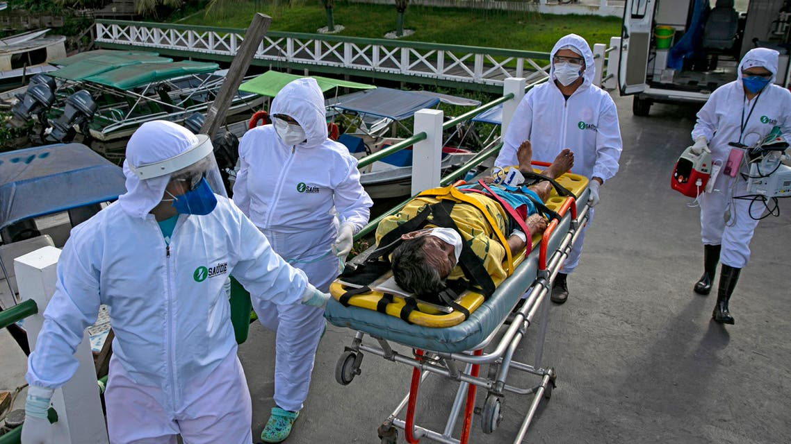 Health personnel carry Brazilian Eladio Lopes, 79, infected with the new coronavirus, on Marajo island in Brazil, on May 25, 2020. (AFP)