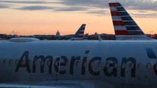 No masks, distancing amid coronavirus: Pictures of American Air flights cause uproar