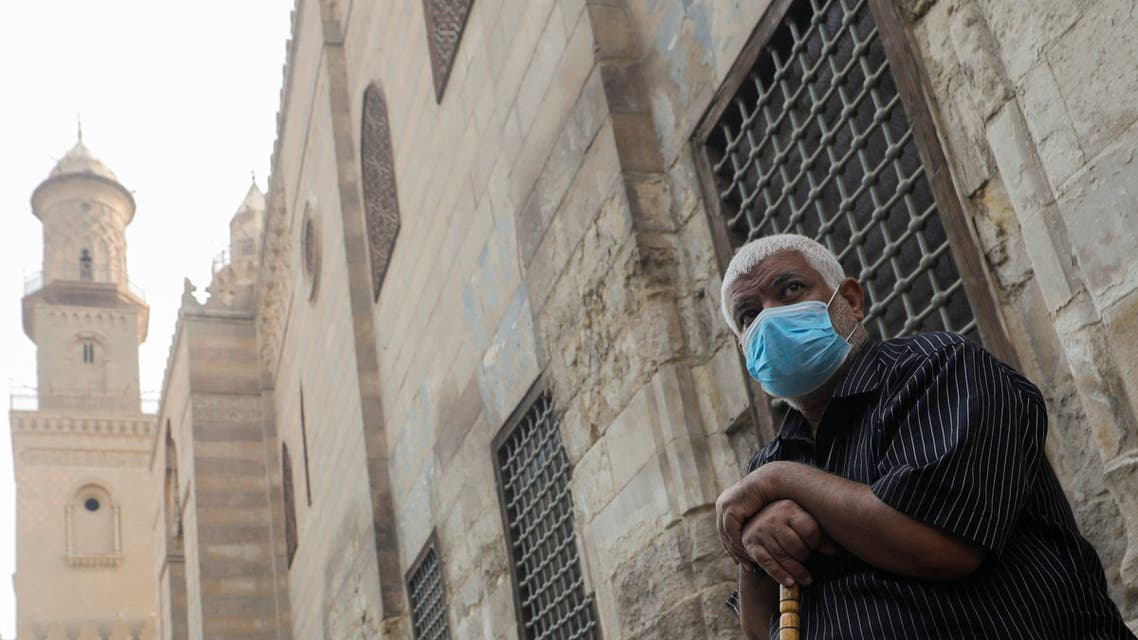 A man wearing a protective face mask, amid concerns over the coronavirus disease (COVID-19), sits before iftar, or breaking fast, during the holy month of Ramadan in front of closed mosques and Islamic schools at El Moez Street in old Islamic Cairo, Egypt April 30, 2020. REUTERS/Amr Abdallah Dalsh