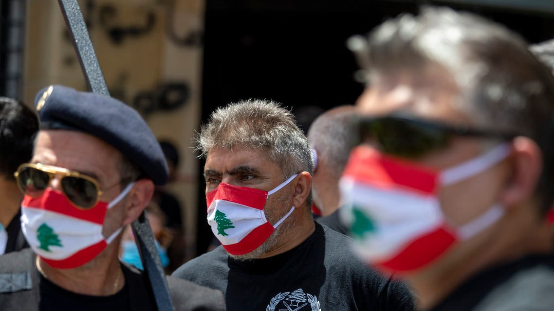 Anti-government protesters wear masks with the colors of the Lebanese flag in Beirut on May 18, 2020. (AP)