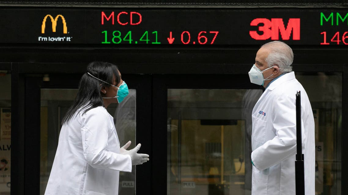 Health care screeners talk outside the New York Stock Exchange, as the trading floor partially reopens on Tuesday, May 26, 2020, in New York. (File photo: AP)