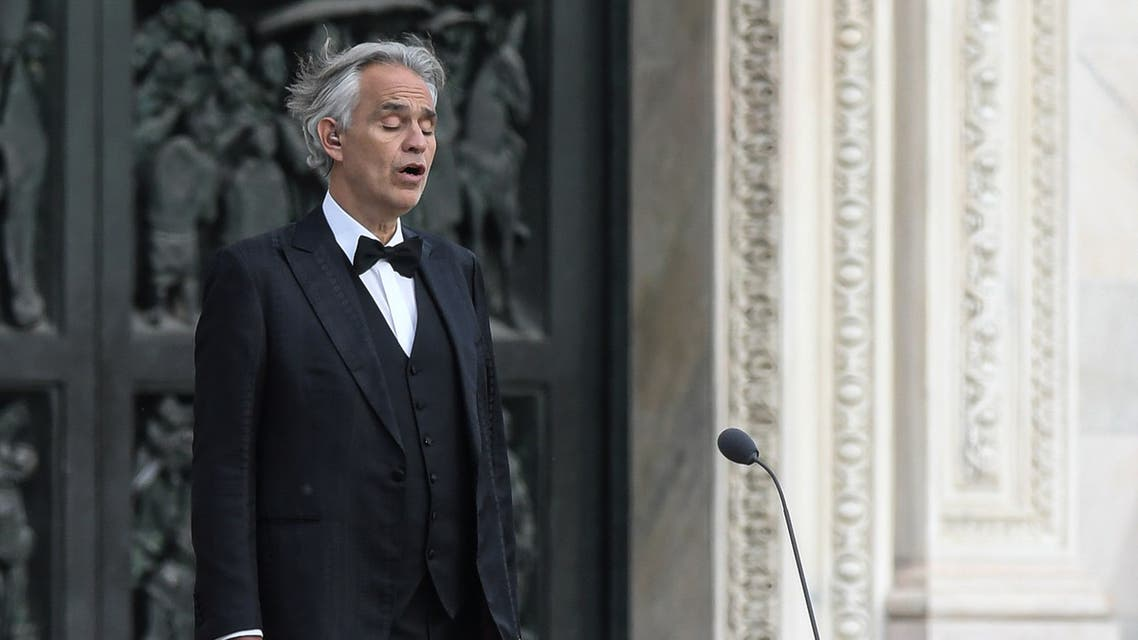 This photo taken on April 12, 2020 shows Italian tenor and opera singer Andrea Bocelli sing during a rehearsal on a deserted Piazza del Duomo in central Milan, prior to an evening performance without public for the world wounded by the pandemic, during the country's lockdown aimed at curbing the spread of the COVID-19 infection, caused by the novel coronavirus. (AFP)