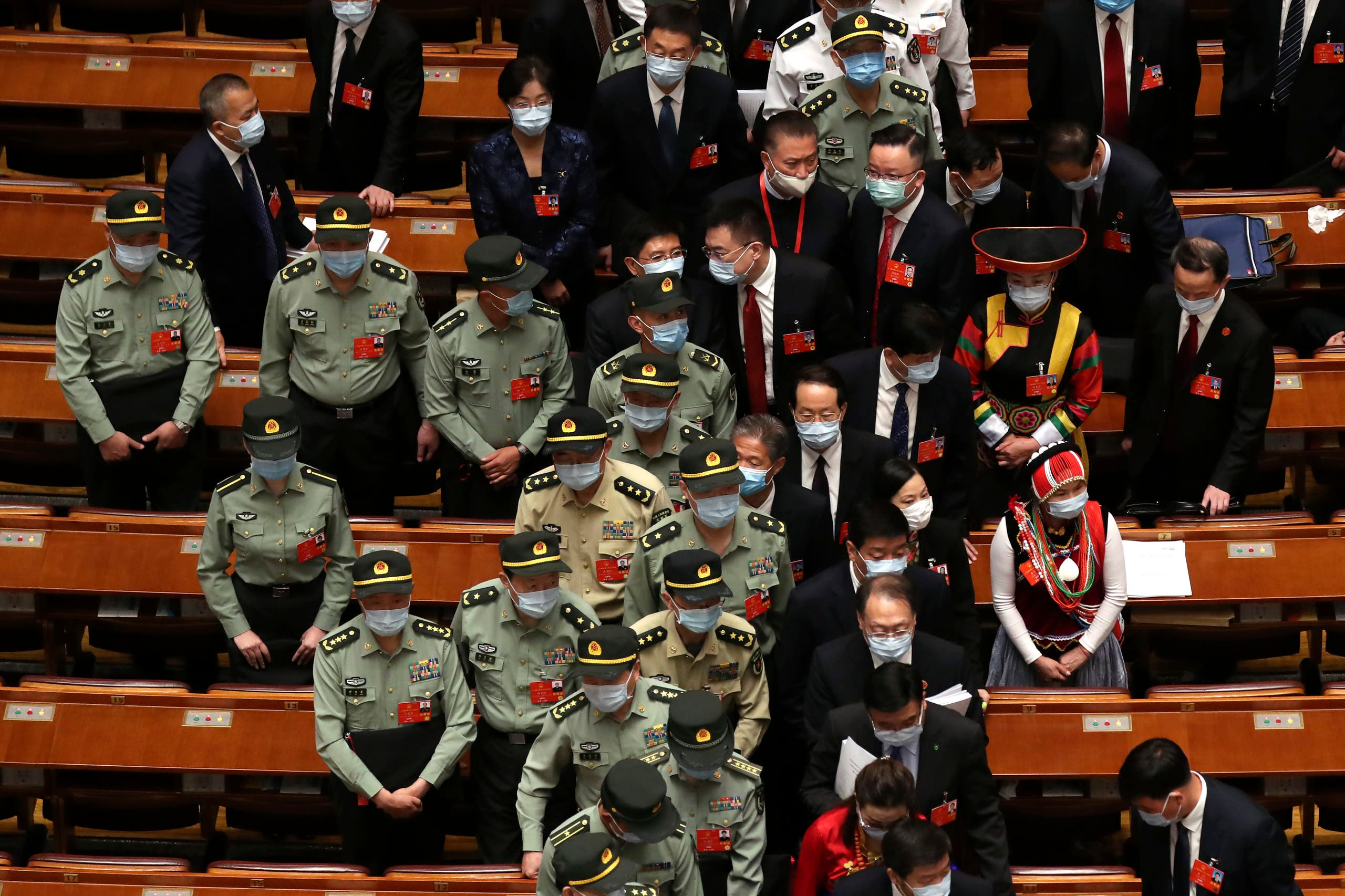 Military delegates leave after the opening session of China's National People's Congress (NPC) at the Great Hall of the People in Beijing on May 22, 2020. (AP)