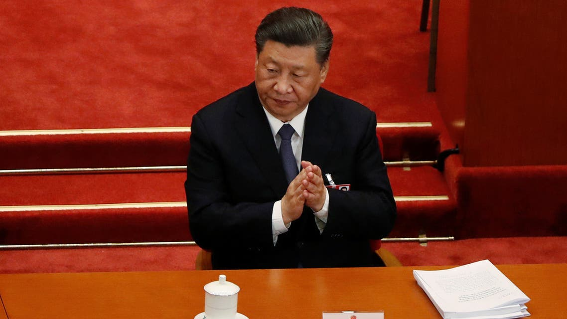 China's President Xi Jinping arrives during the second plenary session of the National People's Congress in the Great Hall of the People in Beijing on May 25, 2020.