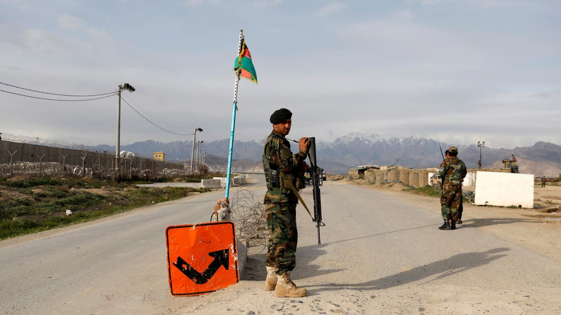 An Afghan National Army (ANA) soldier stands guard at a checkpoint outside Bagram prison, ahead of the release of 100 Taliban prisoners, north of Kabul, Afghanistan April 8, 2020. (Reuters)