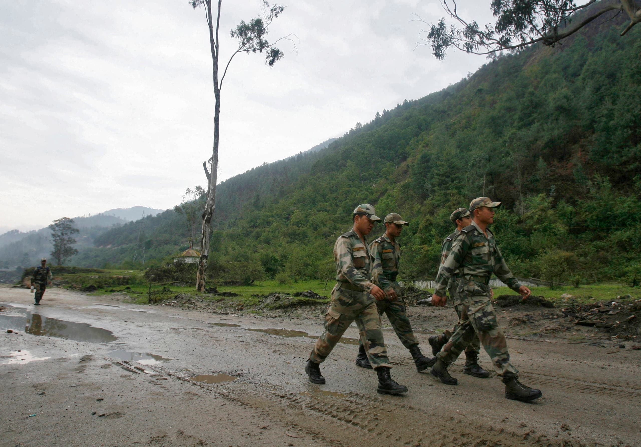 Indian army soldiers march near an army base on India's Tezpur-Tawang highway, which runs to the Chinese border, in the northeastern Indian state of Arunachal Pradesh on May 29, 2012. (Reuters)