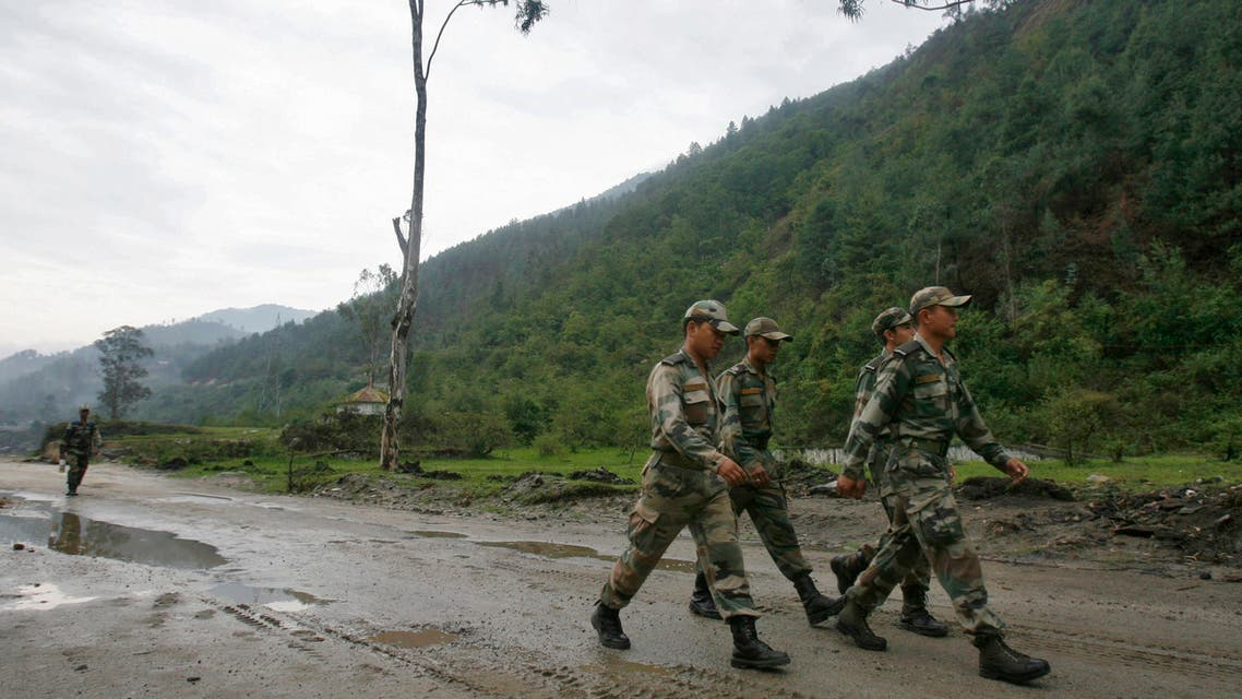 Indian army soldiers march near an army base on India's Tezpur-Tawang highway, which runs to the Chinese border, in the northeastern Indian state of Arunachal Pradesh May 29, 2012. Picture taken May 29, 2012. To match Special Report INDIA-CHINA/ REUTERS/Frank Jack Daniel (INDIA - Tags: POLITICS BUSINESS CONSTRUCTION MILITARY)