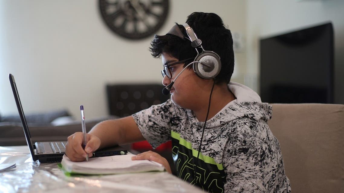 A Bahraini student from government school attends online schooling from home, following the outbreak of the coronavirus disease (COVID-19), in Manama, Bahrain. (AFP)