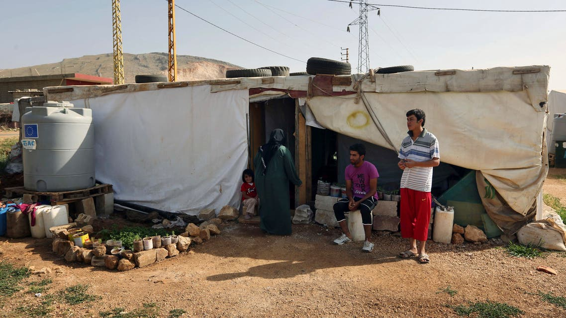 Syrian refugees stand outside their tent at a Syrian refugee camp in the eastern Lebanese town of Majdal Anjar, Lebanon. (File photo: AP)