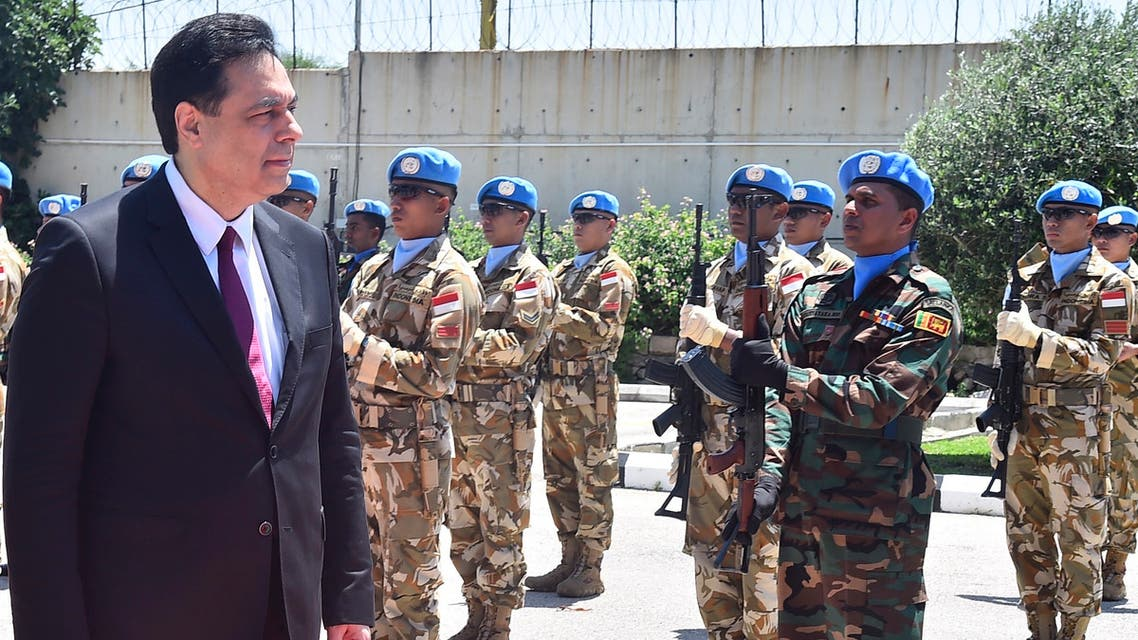 Lebanese Prime Minister Hassan Diab reviews the honor guard of the United Nations peacekeepers, upon his arrival at their headquarters in Naqoura, Lebanon on May 27, 2020. (AP)